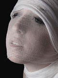A Young Woman with Her Head Wrapped in Gauze Photographic Print by Martina Zancan