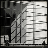 Two People Sitting Outside a Modern Glass Building Photographic Print by Eudald Castells