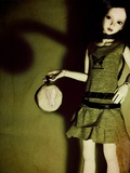 A Doll Holding a Little Round Bag Photographic Print by Kimberley Ross