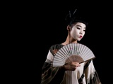 A Young Japanese Woman Wearing a Kimono and Holding a Fan Photographic Print by  RedHeadPictures