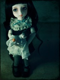 A Sad Looking Doll Photographic Print by Kimberley Ross