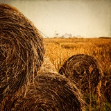 Hay Bales in the Countryside with Industry in the Background Stampa fotografica di Luis Beltran