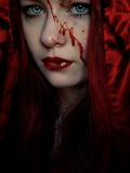 A Girl Wearing a Red Hood with Blood Splattered on Her Face Photographic Print by Elizabeth May