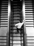 A Man on an Escalator Photographic Print by Rip Smith