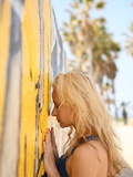 Profile of a Young Woman Facing a Bright Yellow Graffiti Wall in Sunny Venice Beach, California Photographic Print by Jena Ardell