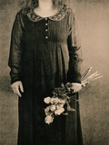 Three Quarters Portrait of Woman Holding Roses Photographic Print by Susan de Witt