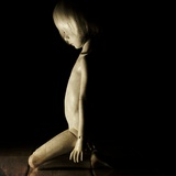 Kneeling Doll Child Photographic Print by Kimberley Ross