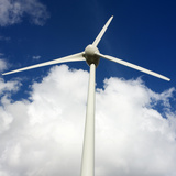 Wind Turbine under Blue Sky Photographic Print by Bernard Jaubert
