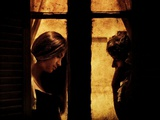 A Young Couple Facing Each Other Behind a Window Photographic Print by Marco Diaz
