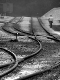 A Man Walking Beside Curving Railway Tracks Photographic Print by Rip Smith