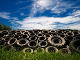 Heap of Old Tyres on Grass, under Blue Sky Photographic Print by Bernard Jaubert