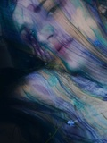 A Young Womans Face Hidden by a Coloured Scarf Photographic Print by Martina Zancan