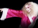 A Young Woman with Long Blonde Hair and Pink Makeup Wearing a Pink Kimono Photographic Print by Martina Zancan