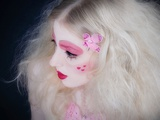A Young Woman with Long Blonde Hair and Pink Makeup with Hearts on Her Cheek Photographic Print by Martina Zancan