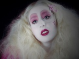 A Young Woman with Long Blonde Hair and Pink Makeup and Red Lipstick Photographic Print by Martina Zancan