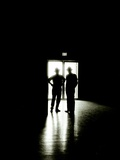 Two Male Figures Silhouetted Against an Exit Doorway Photographic Print by Rip Smith