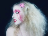 A Young Woman with Long Blonde Hair and Pink Makeup Photographic Print by Martina Zancan