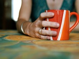 A Hand Holding a Red Mug Photographic Print by Katrin Adam