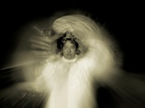 The Glowing Figure of a Woman Dressed in White Photographic Print by Susan Bein