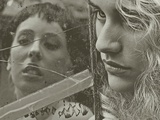 The Face of Two Young Women Reflected in a Cracked Mirror Photographic Print by Martina Zancan