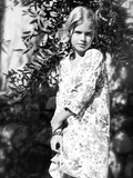 A Young Girl Wearing a White Summer Dress Outdoors Photographic Print by Tanneke Peetoom