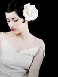 A Young Woman Wearing a White Dress and a White Rose in Her Hair Photographic Print by Martina Zancan