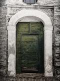 Green door in Penne Fotografisk tryk af Andrea Costantini