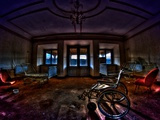 Wheelchair In Dark Empty Room Photographic Print by Nathan Wright
