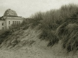 Grassy Sand Dunes and a Large Building Photographic Print by Katrin Adam