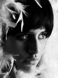The Face of a Young Woman with Feathers Photographic Print by Martina Zancan