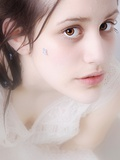 Close Up of a Young Womans Face with Brown Eyes Photographic Print by Martina Zancan