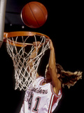 Female Basketball Player Slam Dunking Photographic Print