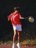 Woman Tennis Player in Action Photographic Print