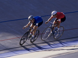 Cyclist Competing on the Velodrome Track Photographic Print