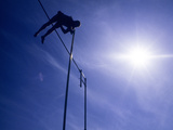 Silhouette of a Pole Vaulter in Action Photographic Print
