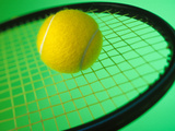 Tennis Ball on Racquet Photographic Print