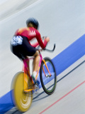 Blurred Action of Cyclist Racing on the Velodrome Photographic Print