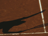Shadow of Tennis Player Serving on Clay Court Photographic Print