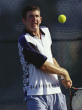Young Male Tennis Player in Action Photographic Print