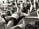Young Woman Working Out with Hand Weights Photographic Print