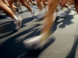 Detail of Runners Legs in A Road Race Photographic Print