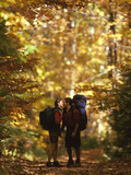 Couple Kissing on the Trail During a Hike Photographic Print