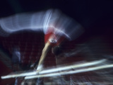 Blurred Action of Male Gymnast on the Parallel Bars Photographic Print