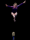 Female Gymnast Performing on the Balance Beam Photographic Print