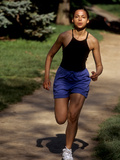 Hispanic Woman Running for Exercise Photographic Print