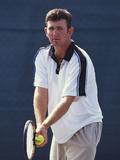 Young Male Tennis Player Serving Photographic Print