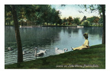 Pueblo, Colorado - Woman on Grassy Lake Clara Bank with Geese Prints by  Lantern Press