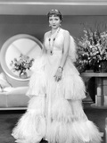 Claudette Colbert, in Gilded Lily, 1935, in Travis Banton Gown Trimmed in Vulture Feathers Photo