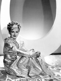 Artists and Models Abroad, Joan Bennett Wearing Gold Lame Negligee Designed by Edith Head, 1938 Photo
