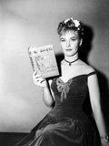 Publicity Shot of Star Joanne Woodward Holding the Bestseller, The Three Faces of Eve, 1957 Posters